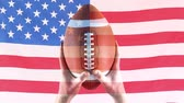 rugby : Digital animation of rugby player holding rugby ball against american flag. American flag swaying in the background 4k Stock Footage
