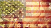 usa : Digital composite of girl at festival crowd surfing against american flag background