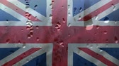 honors : Rain Drops dropping down on glass against British Flag background Stock Footage
