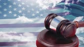 hammers : American flag blowing in the wind with court gavel and blue sky with clouds in background Stock Footage