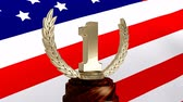 インセンティブ : First Place Throphy against american flag background
