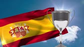 incentive : Silver trophy against Spanish flag blowing in the wind in the sky background Stock Footage