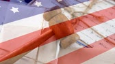 написанный : American flag against written letters background and court gavel background