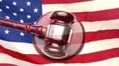 čest : Wooden court gavel against animated american flag background