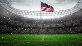 computer graphics : Animated American flag waving in the wind in football stadium with falling snow