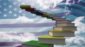 merdiven : Staircase out of school books against american flag waving and blue sky background Stok Video