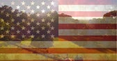 名誉 : Digital composite of American flag on pretty green landscape on sunny day background
