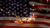 street view : Animated American flag against headlights of cars and traffic background Stock Footage