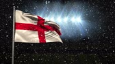 čest : English Flag blowing in the wind at night against animated snow background Dostupné videozáznamy