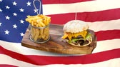 čest : Composite image of burger and fries food plate against animated american flag background