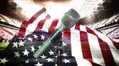 čest : American flag blowing in the wind with animated football stadium in the background and microphone in the forefront