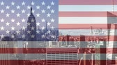идентичность : City skyline with skycrapers against animated american flag background Стоковые видеозаписи