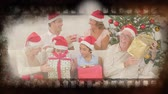 film slate : Old movie tape showing happy family at christmas Stock Footage