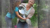 film leader : Old Movie tape showing mother watering plants with daughter