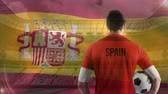 jogador de futebol : Animated Spanish Flag against Soccer player holding football in stadium Vídeos