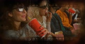 film leader : Old Movie tape showing friends eyjoying a movie at the cinema with popcorn Stock Footage