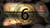 contando : Old blurry movie Countdown against animated clock background Stock Footage