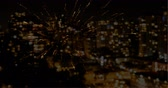 arranjando : Animated firework against city skyline background 4k