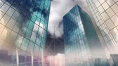 computer graphics : low angle view of sky scrapers made of glass with cloudy dark sky