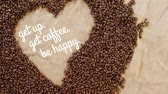 кофе : get up get coffee be happy text handwritten, in a coffee bean made heart shape