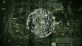 missiles : Digital composite of aerial view of city with a rotating globe and data connections in the foreground Stock Footage