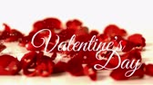 náklonnost : Front view of Valentines day animation with red flower background and dynamic water drop