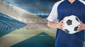 football player : Animation of soccer player that holds a soccer ball against soccer stadium background