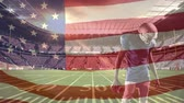 yards : Digital composite front view of american football player preparing to shoot ball with american flag in foreground Stock Footage