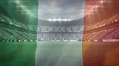 трилистник : Digital composite of an Irish flag waving and a stadium full of fans for St Patricks Day