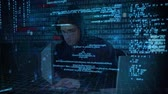 pirátství : Digital composite of smart Caucasian hacker using computer to hack into the system while digital codes move on the foreground Dostupné videozáznamy