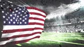 football field : Digital composite of confetti falling down on field while American flag waves in full stadium.