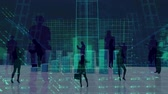 bem vestido : Digital composite of silhouette of business people looking at statistics and stock market data in dark room. Blue coloured bar chart growing and globe moves on the background.
