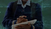 prima infanzia : Digital composite of African American school girl standing and holding a digital tablet with chalkboard on background and mathematics formulas animation in classroom 4k Filmati Stock