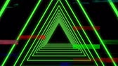 revuelto : Digitally animated of green triangles against black with colorful scrambled TV background Archivo de Video