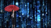 bem vestido : Digital composite of Caucasian businesswoman standing with her red umbrella under a rain of blue binary codes against dark background