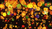 мигать : Digital animation of colorful blinking bokeh effect against black background