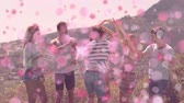composição : Digital composite of friends dancing in the mountains surrounded by an animation of pink bubbles