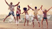 freundlichkeit : Digital animation of multi ethnic friends jumping back to camera, in front of the sea hands to hands on sunset at beach with bubble animation