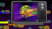 retro television : Front view of an old TV with sizzling screen when TV switch on then pineapple with sunshine against wallpaper pineapple Stock Footage