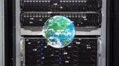 technician : Digital composite of a server, globe rotates in foreground with glowing data around