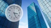 minuto : Digital composite of buildings while clock hands moves at the left side of the screen Stock Footage