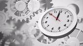 watch icon : Digitally generated white clock. white moving gears in the background. Stock Footage