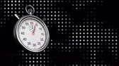второй : Digitally generated silver stopwatch counting to ten while background shows black and white dot pattern