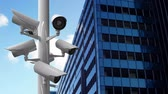 surveillance : Digitally generated surveillance camera working beside a building Stock Footage