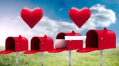 キス : Digital animation of four red mailboxes opening up to send cards out and two heart icons beating above the mailboxes