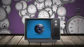 eğlendirmek : Digital animation of a television on top of a wooden plank table with a rotating globe on its screen. The background is filled with timers dropping down Stok Video