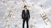 パートナーシップ : Close up of a businessman in a suit with digital animation of floating money in a sky background
