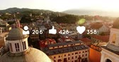 favorito : High angle of a town in the background of digital animation of heart, like and follow icons with numbers increasing 4k Stock Footage