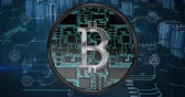 www : Front view of a silver bitcoin sign with background of computer circuit board graphic. 4k