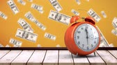 заметка : Digital animation of an alarm clock on top of a wooden plank table with dollar bills flying on an orange background